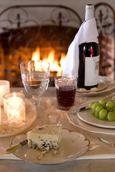 Cheese, Grapes and Wine by the fireplace.