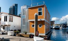 Floating home in Coal Harbour Marina in Vancouver, B.C. - The sleek modern design stands out as the newest floating house built in this harbor with a roof deck to take advantage of the 360-degree view.