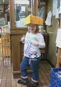 Cindy's ,(Outlet Store Employee), daughter trying on our cheese hat!! | Minerva Dairy