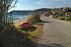 Seafront road along the Mediterranean in the Greek village of Arillas, Corfu, where life is slow and easy and relaxation is the main goal