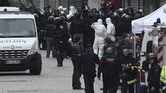 Policemen and firefighters are pictured in the northern Paris suburb of Saint-Denis city centre, on November 18, 2015, as French Police special forces raid an apartment, hunting those behind the attacks that claimed 129 lives in the French capital five days ago. (AFP)