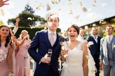 The confetti we allow and which looks beautiful in photos - real petals! Gaynes Park Barns | Epping | Essex » Ed Clayton Wedding Photography