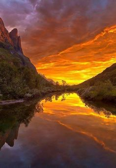 Reflections ~ Orange skies over a lake in Norway.