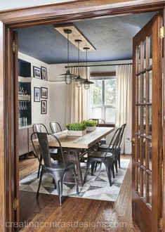 In love with White Dove by Benjamin Moore? The colour is featured here in this dining room with Benjamin Moore's Hale Navy.