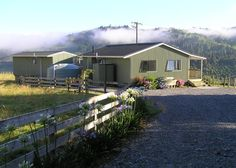 The Green Trout in Mangaweka   Bookabach   New Zealand with baths out on the deck over looking the river .