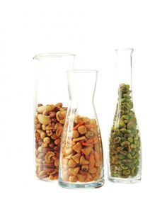 nstead of a communal bowlful o' nuts at your next get-together, try a more hygienic presentation by putting the snacks and party mix in clear-glass narrow-necked decanters // Cocktail Party Ideas - Martha Stewart Cocktail Hour