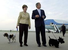 President Bush and first lady Laura Bush, with their dogs Barney, right, and Spot, left, talk with the media after arriving in Waco, Texas, Tuesday evening, Nov. 13, 2001.