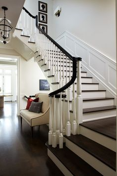 Stairs, wainscoting, curved railing, spiral newel post