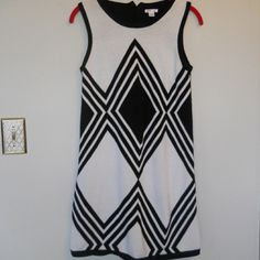 Knit dress Black and white sweater dress. Comes to mid thigh so its awesome with legging. Exhilaration Dresses