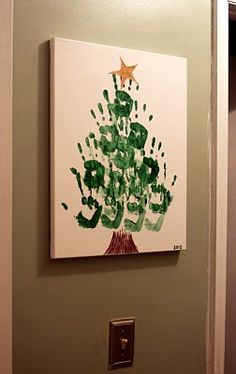 hand print christmas tree@Stacey Mitchell we did these at WCP, and the parents thought they were adorable..we did their thumbprints all over in different colors to look like lights. (we also did their handprints upside down, it looked more tree-like to me that way!)