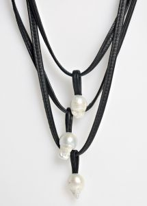$900   Monies 3 Strand Pearl Necklace   Monies jewelry is bold in design and strong in aesthetic. This Monies necklace is made with Ebony, Leather, and Pearl, to become a one-of-a-kind and edgy statement piece. All pieces are handmade. Monies is sold online and in-store at Santa Fe Dry Goods & Workshop in Santa Fe, New Mexico.