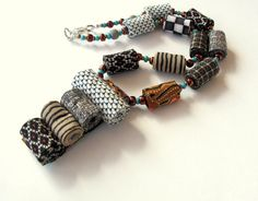 African tribes inspired artistic fiber necklace in by Gilgulim, $56.00