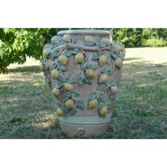 Terracotta jar decorated with hand painted lemons. Every terracotta object can be decorated with patterns and decorations, both from classic and moder tradition, entirely handmade. Every-day objects suggesting ancient traditions, imperishable in time as moulded in extremely antifreeze clays.