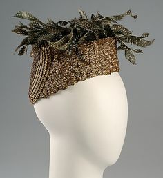 Toque Sally Victor  (American, 1905–1977) Date: 1940 Culture: American Medium: Straw, feathers Credit Line: Brooklyn Museum Costume Collection at The Metropolitan Museum of Art, Gift of the Brooklyn Museum, 2009; Gift of Sally Victor, 1941