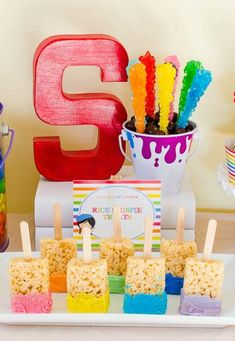 Rock candy and Rice Krispie paintbrushes at an art birthday party! See more party ideas at CatchMyParty.com!