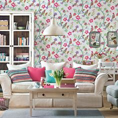Pink-floral-wallpaper-with-bright-print-cushions-Dominic-Blackmore
