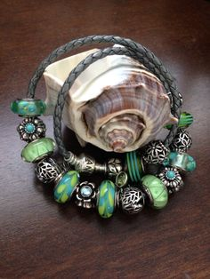 My green and blue Pandora gray leather bracelet! Nicole