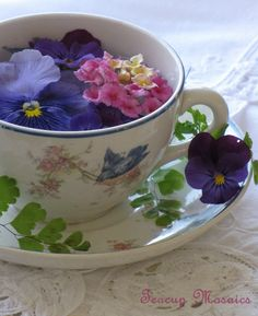 Floating Flowers in a Teacup - This makes a pretty centrepiece for a Spring or Summer tea party / Photo by Kelley on Flickr