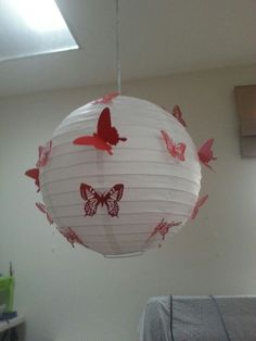Paper lamp decorated with butterflies
