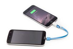 A cable that allows you to share battery between phones. | 25 Products You Need If You Love Your Phone