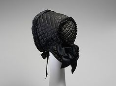 Bonnet, 1800-1900 | Okay, I'll admit that dating bonnets can be hard, but 100 years? That's quite a bit of wiggle room, especially for a national museum. This is a mid-Victorian winter bonnet, probably dating between 1850 and 1870. 20 years is still a wide swathe. Any bonnet experts care to chime in?