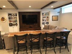 Installing a bar in your home is a great way to make sure that when you have company over everybody has a fun place to spend time together. A dedicated bar spac Home Bar Table, Bar Tables, Live Edge Bar, Basement Bedrooms, Basement Bathroom, Modern Basement, Teen Basement, Basement Apartment, Basement Plans
