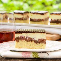 Donauwelle Kuchen (Danube Wave Cake) with layers of vanilla and chocolate cake, cherries, German buttercream, and chocolate ganache.