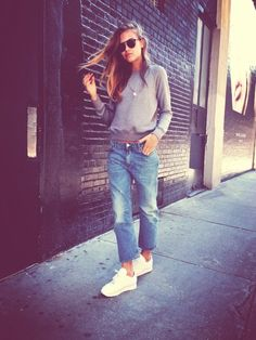 Sporty chic baggy grey jumper with boyfriend jeans and white trainers