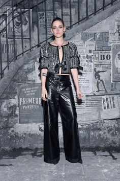 Kristen Stewart at Chanel's Metiers d'Art pre-fall 2016 show in Rome wearing a silver top and black trousers