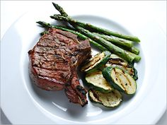 grilled pork chops marinated w/ rosemary and red wine; serve w/grilled asparagus and zucchini tossed in your favorite vinaigrette