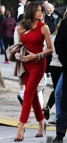 Melania Trump wearing a red jumper and pointed toe heels. Beauty on High Heels #Fashion