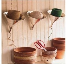 Martha Stewart has a cute and fun way to organize string, small rope using oil funnels