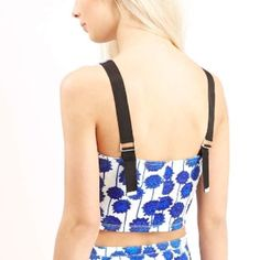 """Topshop Crop Top Festival ready! Floral grosgrain strap top! Bold florals pack a punch - this sleeveless top comes with thick adjustable grosgrain straps for added edge. 94% Polyester, 6% Elastane. 16.5"""" L not counting adjustable strap! Topshop Tops Crop Tops"""