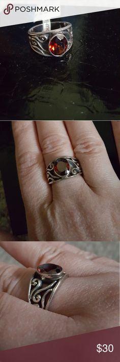 Sterling silver and garnet ring Sterling silver and garnet ring size 6.5-7 Jewelry Rings