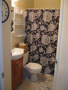 Black/White/Beige Bathroom - Myriad shelves from The Container Store; Peony shower curtain by Watershed.
