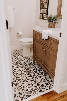 Small Bathroom Renovations 522417625523152136 - Black and white tile with a walnut vanity are perfection in this modern farmhouse style renovation Source by glhne Bathroom Floor Tiles, Bathroom Renos, Bathroom Renovations, Home Remodeling, Bathroom Ideas, Master Bathroom, Cozy Bathroom, Bathroom Vanities, Black And White Tiles Bathroom