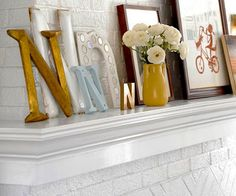 Inspiration for my boring white brick fireplace in the apartment. I can't wait to make it look this cute!
