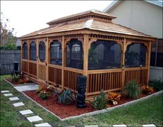 I saw some of the most beautiful Amish built gazebos just like this one in Shipshewana, IN. (2006) <3