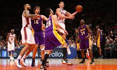 Jeremy Lin of the New York Knicks rises above Jason Kapono, Pau Gasol and Kobe Bryant of the Los Angeles Lakers at Madison Square Garden.