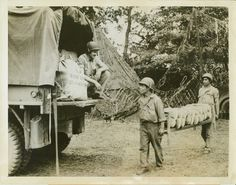 https://flic.kr/p/frTd7C | 77.09.4421a | New York Bureau.Here's Bread For The Fighters.Somewhere in France -- Beginning delivery of the Staff of Life to Yanks fighting on the Normandy front, these Texans load fresh loaves of bread on an Army truck. Pvt. Garth Gilbert of Huntington, Tex., squats on the truck as Cpl. Antonio Palacio of El Paso, and Cpl. Manuel Ricondo (in rear) of San Antonio, bring up the loaves..Credit: ACME.Date: 7-17-44