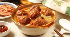 Lion's head meatballs is a Shanghai casserole dish featuring oversized pork meatballs and bok choy. It is traditionally cooked in a sand clay pot. Easy Bok Choy Recipes, Spicy Recipes, Asian Recipes, Cooking Recipes, Ethnic Recipes, Cooking Dishes, Czech Recipes, Lamb Recipes, Asian Foods