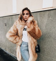 Cute cozy faux fur coat with white tee and blue jeans.