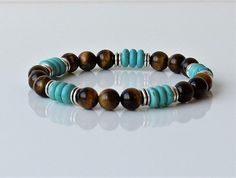 Combined Bracelet, Tiger Eye stone 8 mm ,Rondel Turquoise stone 8 mm, Crafted on a Strong Stretch Cord Bracelet. When you need a boost of creative energy, reinforces the ability and motivation to do. Men Beaded Bracelet, Gemstone Bracelet Men, Men Energy Bracelet, Tiger Eye Bracelet,