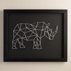 """""""There are aspects in nature that may seem completely simple, but when you take a closer look, you will discover the array of complex lines and patterns,"""" says artist Christine Tong. Her contemporary piece captures this multifaceted aspect of nature with a geometric rhinoceros made of white string on a black backdrop."""
