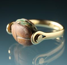 Ring | Torun Bülow-Hübe.  18k gold and a 3000 year old Egyptian scarabe. c. 1960s