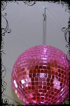 Every studio needs a pink disco ball!  I totally agree! I want one for the office!