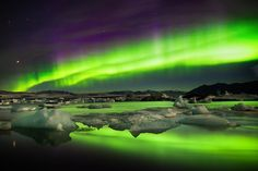 Purple head-dress, curtains and clouds over glacial ice.  Learn my secrets to catching the auroras with your camera on my BLOG.