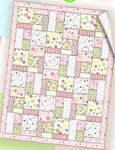 Soft colors and fabrics can be used when sewing this simple baby quilt and small pillow. Choose from boy's or girl's colors, or make it neutral with nursery