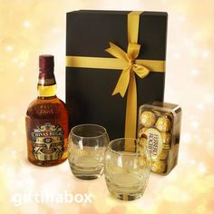 CHIVAS REGAL WHISKEY SET The regal of whiskeys! For that very special someone or very special ocassion! 1 x 12 Year Old Chivas Regal whiskey 2 x whiskey tumblers 16 Ferrero Rocher chocolates in box Hard Drinks, South African Wine, Ferrero Rocher Chocolates, Whiskey Gifts, Gifts Delivered, Wine And Liquor, Gift Hampers, Corporate Gifts, Special Gifts