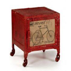 Mesa auxiliar vintage BENTO con ruedas. Está fabricada en hierro rojo con una puerta de madera. Productos creados del reciclado de muebles y maderas de palets. Combina esta mesa con otros muebles de nuestra colección vintage para crear una sensación industrial en tu hogar.